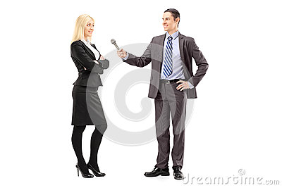 Full length portrait of a businesswoman and male reporter having
