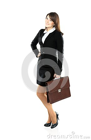 Full length portrait of a businesswoman walking with a briefcase