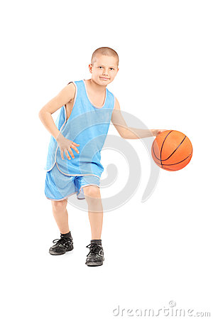 Full length portrait of a child playing with a basketball