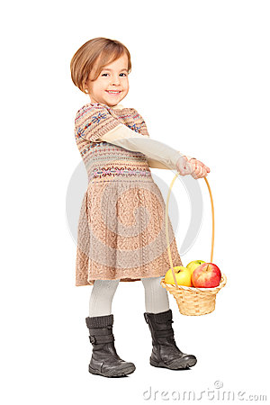 Full length portrait of a cute little girl holding a basket with