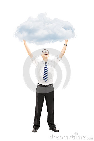 Full length portrait of an excited young man holding a cloud