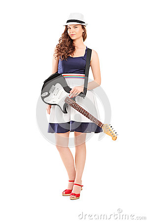 Full length portrait of a female with an electric guitar
