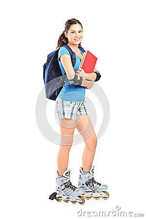 Full length portrait of a female student on roller skates