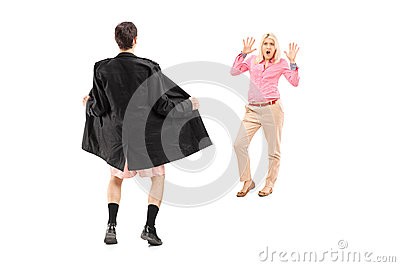 Full length portrait of a flasher scaring a young woman