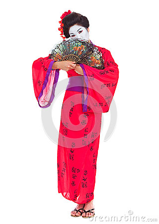 Full length portrait of geisha hiding behind fans