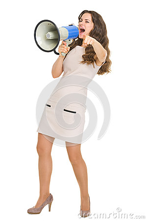 Full length portrait of girl shouting in megaphone