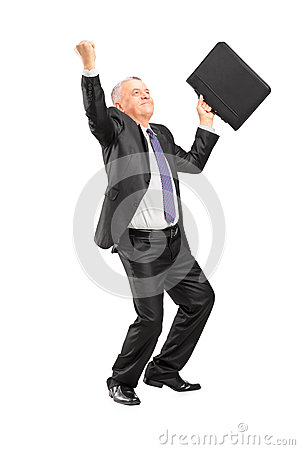 Full length portrait of a happy mature businessman with raised h