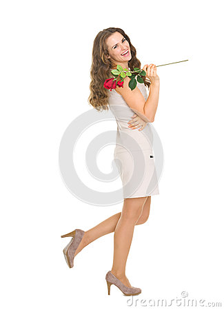 Full length portrait of happy woman with red rose