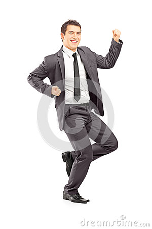 Full length portrait of a happy young businessman gesturing happ