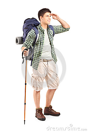 Full length portrait of a hiker with backpack looking