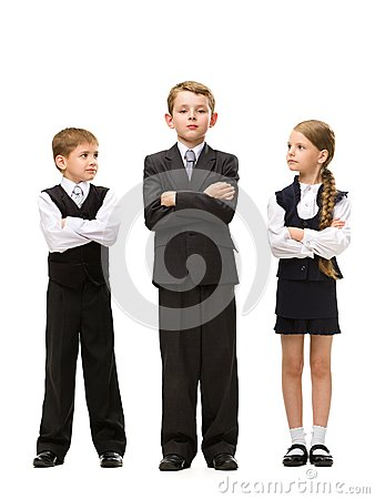 Full length portrait of little children with hands crossed