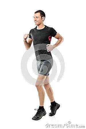 Full length portrait of a male athlete running
