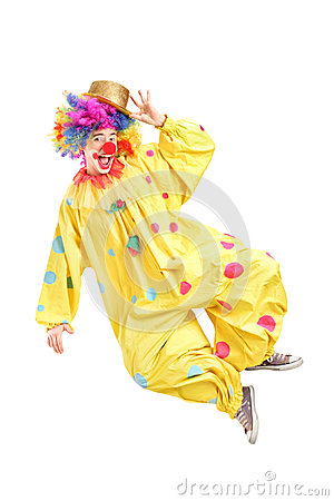 Full length portrait of a male clown jumping and gesturing