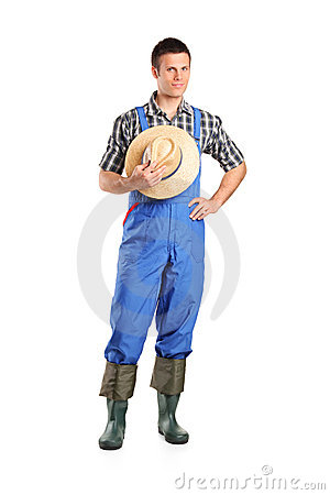 Full length portrait of a male farmer posing