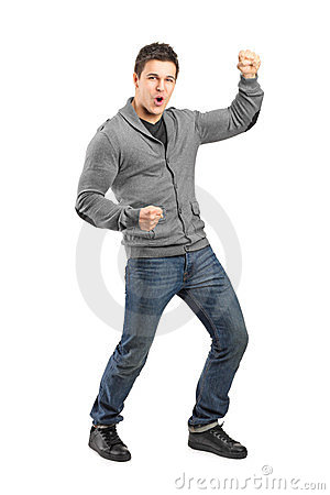 Full length portrait of a male gesturing happiness