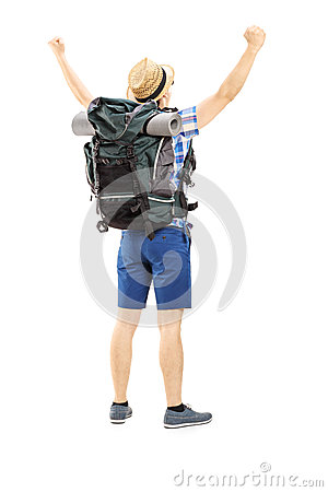 Full length portrait of a male hiker with raised hands gesturing