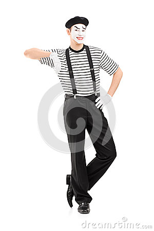 Full length portrait of a male mime artist posing