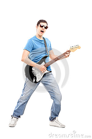 Full length portrait of a male musician playing an electric guit