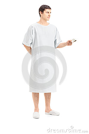 Full length portrait of a male patient offering money