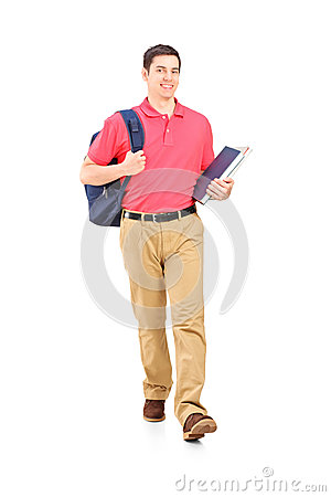 Full length portrait of a male student walking