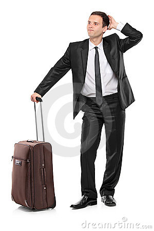 Full length portrait of a man with a suitcase