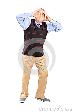 Full length portrait of a mature man holding his head in pain