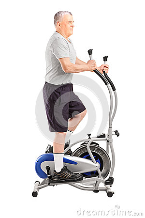 Full length portrait of a mature sporty man exercising  on a cro