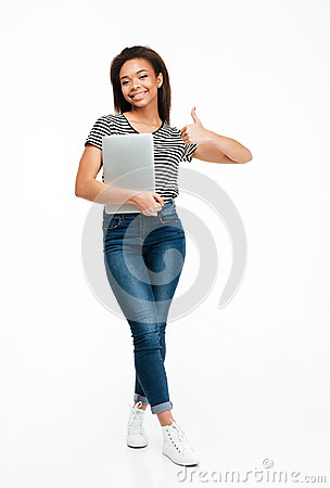 Free Full Length Portrait Of A African Teenager Girl Holding Laptop Stock Photography - 95623642