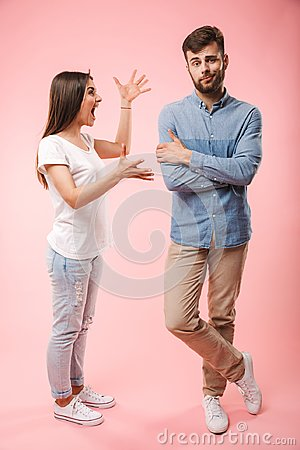 Free Full Length Portrait Of A Mad Young Couple Stock Image - 117779141