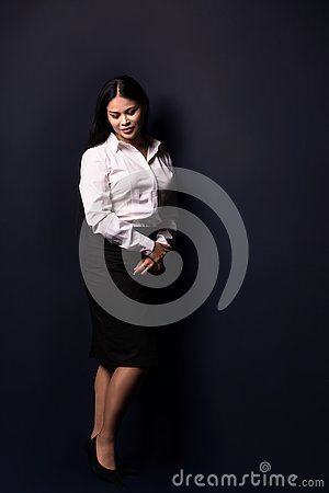 Free Full Length Portrait Of A Young Beautiful Businesswoman Stock Photos - 129729943