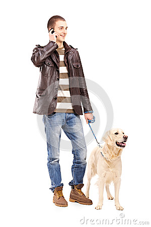 Free Full Length Portrait Of A Young Man Walking A Dog And Talking On Royalty Free Stock Photos - 30655498