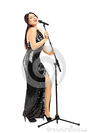 Free Full Length Portrait Of A Young Woman In Black Dress Singing Stock Images - 35273304