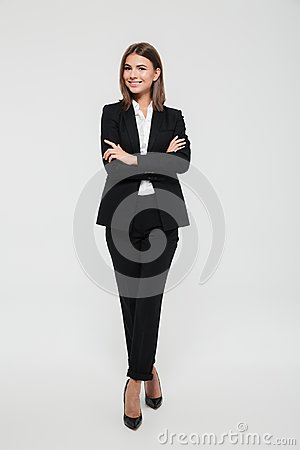Free Full Length Portrait Of An Attractive Smiling Businesswoman Royalty Free Stock Image - 103140636