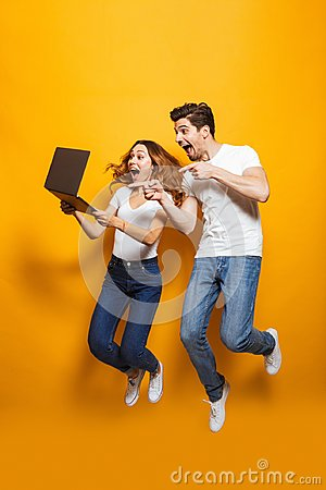 Free Full Length Portrait Of Excited Man And Woman Jumping And Using Royalty Free Stock Photography - 124181707