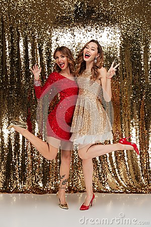 Free Full Length Portrait Of Two Smiling Women In Sparkly Dresses Royalty Free Stock Photos - 104392578