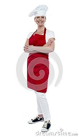 Full length portrait of pretty female cook