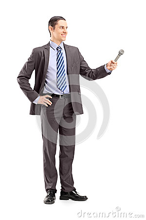 Full length portrait of a professional male reporter holding a m