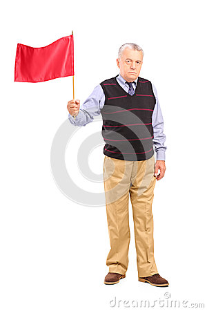 Full length portrait of a sad senior man waving a red flag