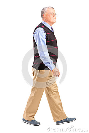 Full length portrait of a senior man walking