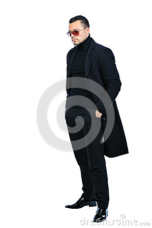Full length portrait sexy man in black coat isolated