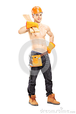 Full length portrait of a shirtless muscular male construction worker