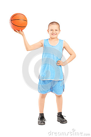 Full length portrait of a smiling child holding a basketball