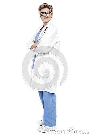 Full length portrait of a smiling female doctor