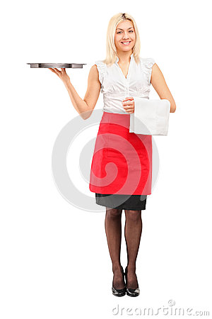 Full length portrait of a smiling female waitress holding a tray