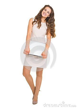 Full length portrait of smiling woman with laptop