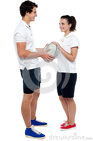 Full length portrait of sporty guy and girl