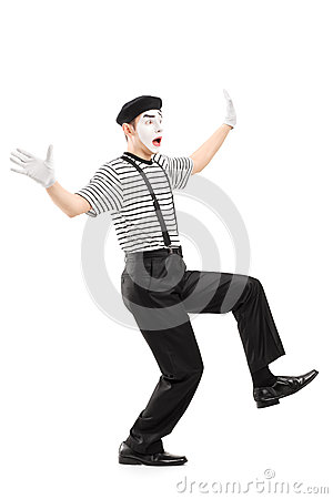 Full length portrait of a surpised mime artist gesturing