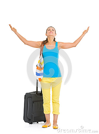 Full length portrait of tourist woman with wheel bag enjoying