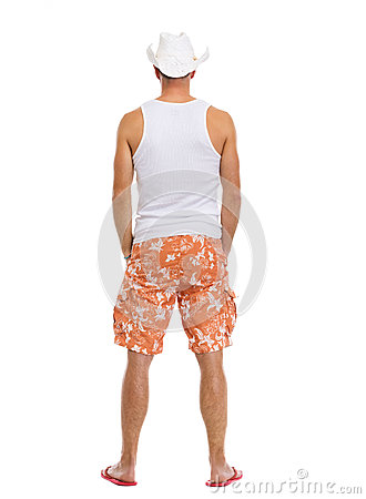 Full length portrait of on vacation man in shorts