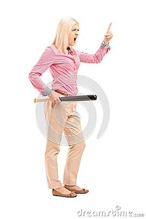 Full length portrait of a violent woman holding a baseball bat